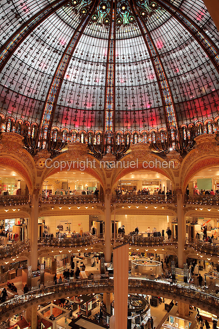 Department store Galeries Lafayette, opened 1912, on Boulevard Haussmann, 9th arrondissement, Paris, France. The shop was designed by Georges Chedanne and his pupil Ferdinand Chanut, with a huge glass and steel dome, art nouveau staircases and 3 levels of balconies. Picture by Manuel Cohen