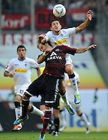 FUSSBALL   1. BUNDESLIGA   SAISON 2011/2012    7. SPIELTAG Borussia Moenchengladbach - 1. FC Nuernberg         24.09.2011 Raul BOBADILLA (Moenchengladbach) im Zweikampf mit Javier PINOLA (Nuernberg) obenauf