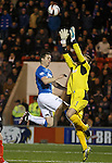 Jon Daly challenges Airdrie keeper Danny Rodgers
