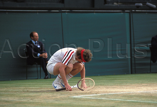 July 1980: American player JOHN McENROE sinks to his knees in anguish during his Wimbledon Men's Singles Final defeat to Borg Photo: Leo Mason/Action Plus...tennis loser losing disappointment lose man 8007