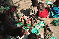 MPHANDULA, MALAWI - AUGUST 21: Unidentified orphans eat lunch in a pre-school on August 21, 2006 in Mphandula village, about 30 miles outside Lilongwe, Malawi. Mphandula is a poor village in Malawi, without electricity or clean water. Nobody owns a car or a mobile phone. Most people live on farming. About 7000 people reside in the village and the chief estimates that there are about five-hundred orphans. Many have been affected by HIV/Aids and many of the children are orphaned. A foundation started by Madonna has decided to build an orphan center in the village through Consol Homes, a Malawi based organization. Raising Malawi is investing about 3 million dollars in the project and Madonna is scheduled to visit the village in October 2006. Malawi is a small landlocked country in Southern Africa without any natural resources. Many people are affected by the Aids epidemic. Malawi is one of the poorest countries in the world and has about 1 million orphaned children. (Photo by Per-Anders Pettersson)