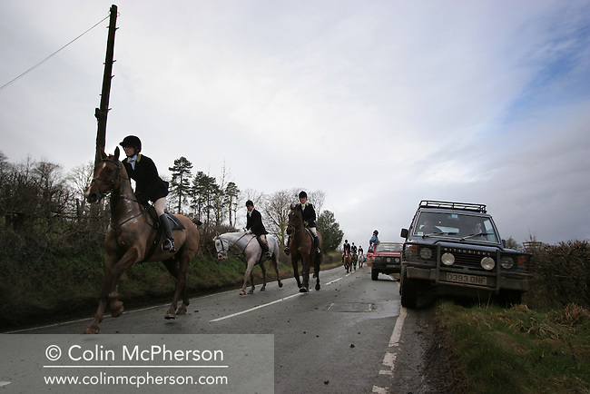 The Wynnstay Hunt canter down a country lane in pursuit of a fox. The Wynnstay Hunt, named after Sir Watkin Williams-Wynn, dated back to the 18th century and hunted on country estates in Shropshire, Cheshire and north Wales. Hunting with dogs in England and Wales became illegal on 18th February 2005 despite legal challenges to the ban and many hunts vowed to continue the ancient sport of foxhunting, risking prosecution.