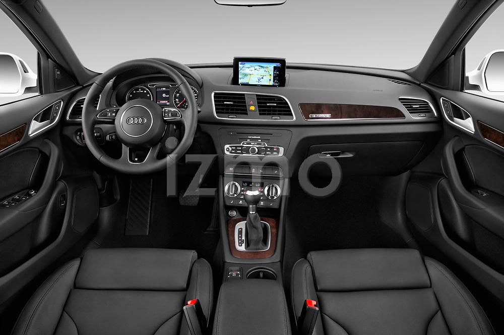 Stock photo of straight dashboard view of 2015 Audi Q3 Premium Plus 5 Door SUV
