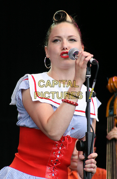 IMELDA MAY .Cornbury Music Festival near Charlbury, Oxford.July 6th 2008.stage concert live gig performance music half length blue white red corset striped stripes top sailor collar microphone singing.CAP/JIL.©Jill Mayhew/Capital Pictures