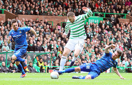 21.04.2013 Glasgow, Scotland. Gary Hooper is stopped by Josh Meekings during the Scottish Premier League game between Celtic and Inverness Caledonian Thistle from Celtic Park.