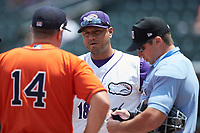 Winston-Salem Dash coach Guillermo Quiroz (18) meets with home plate umpire Matthew Brown and Buies Creek Astros manager Morgan Ensberg (14) prior to the start of their Carolina League game at BB&T Ballpark on July 15, 2018 in Winston-Salem, North Carolina. The Dash defeated the Astros 6-4. (Brian Westerholt/Four Seam Images)