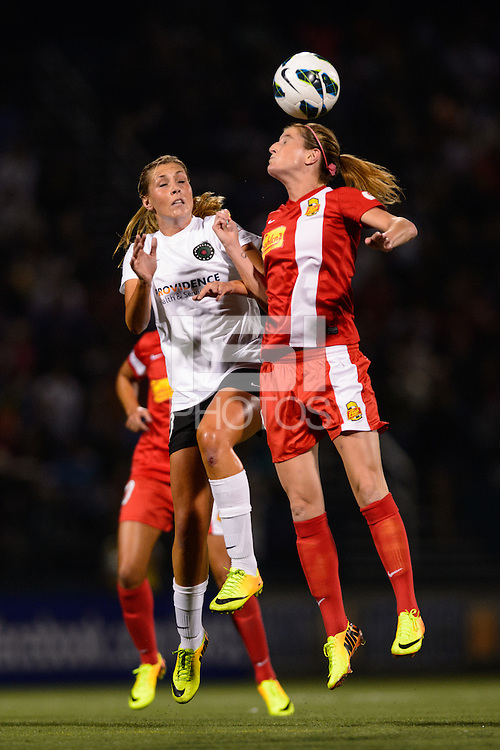 Portland Thorns midfielder Allie Long (10) goes up for a header with Western New York Flash forward Adriana Martin (8). The Portland Thorns defeated the Western New York Flash 2-0 during the National Women's Soccer League (NWSL) finals at Sahlen's Stadium in Rochester, NY, on August 31, 2013.