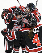 Kendall Coyne (Northeastern - 77), Colleen Murphy (Northeastern - 10), Maggie DiMasi (Northeastern - 4) - The Boston University Terriers defeated the visiting Northeastern University Huskies 3-2 on Saturday, January 28, 2012, at Agganis Arena in Boston, Massachusetts.