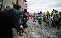 Tom Boonen (BEL/Etixx-QuickStep), Sep Vanmarcke (BEL/LottoNL-Jumbo) &amp; Kris Boeckmans (BEL/Lotto-Soudal) at the front of the peloton, cheered over the Oude Kwaremont<br /> <br /> 67th Kuurne-Brussels-Kuurne 2015