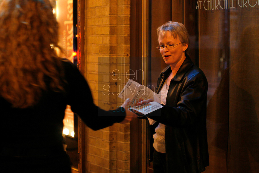 Cellist Mary Kenney hands out flyers to passersby at the Fox Theatre as members of the Atlanta Ballet Orchestra picket a performance of &quot;The Nutcracker.&quot; Last summer the Atlanta Ballet announced it would begin using recorded music for all of its productions and fired the orchestra. The American Federation of Musicians Local 148-462 has filed an unfair labor practice complaint. (Contact info: Mary Kenney of the orchestra (404) 888-0787)<br />