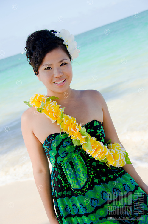 Bikaryoo wearing a flower lei at the beach