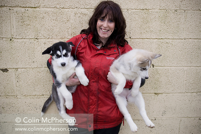 Debbie Pullen pictured with two 12-week-old huskies at her farm at Staintondale, north Yorkshire. In September 2006, Debbie and her husband Michael set up Pesky Husky Trekking, which allows visitors to their farm the experience of being pulled on a scooter by Siberian huskies either on a purpose-built training track or a nearby disused railway line. By diversifying their farming business they were aiming to make their farm more financially viable.