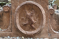 """Detail of the tomb of Jehuda Liva Ben Becalel or Rabbi Low, 1609, with a rearing lion carved within an elliptical garland, in the Old Jewish Cemetery, in the Josefov or Jewish Quarter of Prague, Czech Republic. The original cemetery was called """"The Jewish Garden"""" and was excavated under the Vladislavova street, New Town. Because Jewish graves cannot be moved, when the cemetery became full, more earth was put on top and the tombstones shuffled up, until there were 12 layers of tombs and approximately 12,000 tombstones presently visible, although there may be as many as 100,000 burials in all. Others buried here include Mordechai Maisel (d. 1601), David Gans (d. 1613) and David Oppenheim (d. 1736). The historic centre of Prague was declared a UNESCO World Heritage Site in 1992. Picture by Manuel Cohen"""