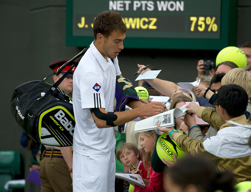 Jerzy Janowicz (POL) signs autographs as he leaves the court after his victory over Lukasz Kubot (POL) in their Gentlemen's Singles Quarter-Finals match today - Jerzy Janowicz (POL) [24] def Lukasz Kubot (POL) 7-5 6-4 6-4 <br /> <br />  (Photo by Stephen White/CameraSport) <br /> <br /> Tennis - Wimbledon Lawn Tennis Championships - Day 9 Tuesday 3rd July 2013 -  All England Lawn Tennis and Croquet Club - Wimbledon - London - England<br /> <br /> &copy; CameraSport - 43 Linden Ave. Countesthorpe. Leicester. England. LE8 5PG - Tel: +44 (0) 116 277 4147 - admin@camerasport.com - www.camerasport.com.