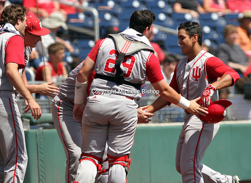 Laren Eustace is greeted by teammates after his two-run home run in the eighth inning. Indiana's 6-2 win eliminated Nebraska from the Big Ten Tournament at TD Ameritrade Park in Omaha, Neb. on May 26, 2016. (Photo by Michelle Bishop)