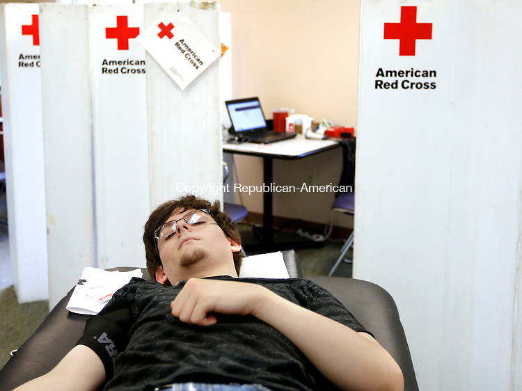 Winsted, CT- 15 June 2015-061515CM02-  Jagger Dillon of Winsted donates blood during a blood drive at the Winsted Ambulance headquarters in Winsted on Monday.  The drive was put on by the Winsted Area Ambulance Association, which holds a blood drive every two to three months said Amber Wald, blood drive coordinator.  Wald said the drive usually receives 25-40 donators.   Christopher Massa Republican-American