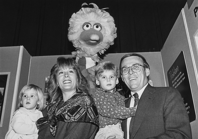 Rep. Byron Dorgan, D-N.D., and his family, Haley (age 1.5), wife Kimberly, Brenton (almost 4) with Big Bird. Tech Fair Reception held in Hart sponsored by PBS and public TV had several displays including Sesame Street and of course Big Bird on March 7, 1991. (Photo by CQ Roll Call via Getty Images)