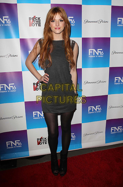 Bella Thorne.Paramount Studios' 16th Annual Friends 'N' Family Party Held At Paramount Studios, Los Angeles, California,.USA, 8th February 2013..full length hand on hip grey gray dress black tights .CAP/ADM/KB.©Kevan Brooks/AdMedia/Capital Pictures.