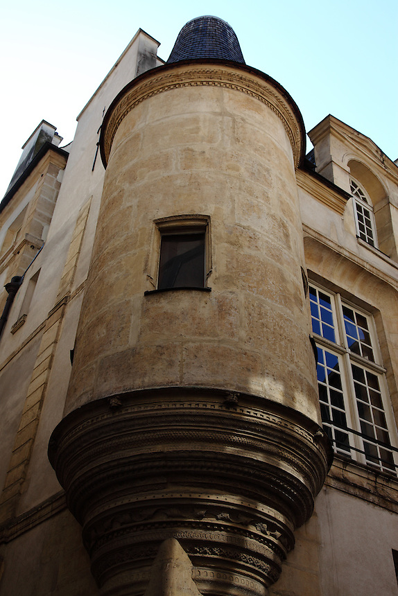 A view of a particular of an old building in the Marais, Paris: A gatekeeper's lodge. Digitally Improved Photo.