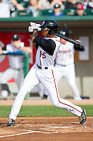 Dalton Pompey (15) of the Lansing Lugnuts follows through on his swing against the Beloit Snappers at Cooley Law School Stadium on May 5, 2013 in Lansing, Michigan.  The Lugnuts defeated the Snappers 5-4.  (Brian Westerholt/Four Seam Images)