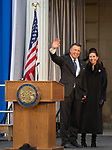 Governor Brian Sandoval, with wife Lauralyn McCarthy, gives one last wave as governor before Governor-elect Steve Sisolak is sworn into office on the steps of the Nevada State Capitol in Carson City, Nev., Monday, Jan. 7, 2019. (AP Photo/Tom R. Smedes)