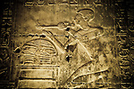 Wall relief portraying an Egyptian Pharaoh making offerings at Abydos Temple, Egypt