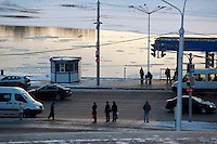 People wait for buses and minibuses in Ufa, Bashkortostan, Russia.