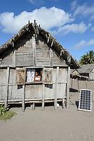 MADAGASCAR, Mananjary region, village AMBOHITSARA, hut with solar home system / MADAGASKAR Mananjary, Dorf AMBOHITSARA, Huette mit solar home system