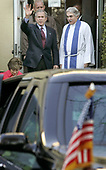 "United States President George W. Bush (L) waves next to Rev. Luis Leon after attending church at St. John's Church December 11, 2005 in Washington, DC. St. John's is also known as ""The President's Church"" because it is directly across Lafayette Park from the White House. <br /> Credit: Chip Somodevilla / Pool via CNP<br /> <br /> Pool Report #1 - 12/11/05 -- Your poolers arose with the songbirds and barely had time to hit Starbucks before the motorcade was rolling. By 7:40 am, Potus and Mrs. Bush were in their car, on the way to St. John's Church, where they sat on the left side of the center aisle, about three rows back. Robert Mueller was across the aisle.  Rev. Luis Leon gave the sermon, talking about the important of not compartmentalizing faith by simply attending church and following ritual.  ""We have to experience God, we don't want to create a box around'' religion he said. He veered into the political by discussing the ""checklists'' some apply to faith, with questions such as ""Are you for same-sex marriage or not.'' That drew laughter; from where we were sitting in the back we could not see if either the President or Mrs. Bush joined in the laughter. He discussed emails he received, including one from someone who asked ""How dare you preach in front of the President,'' and apparently assuming that because Rev. Leon was born in Guantanamo he was a follower of ideologies the president should not be hearing about.   ""Well, hello, I'm rector of the church,'' he said with a laugh.  He concluded with: ""Expect the unexpected. God offers maximum support but minimum protection.''  The pool got a brief wave from POTUS as he exited the church, then we did the world's shortest motorcade in reverse. Within 10 minutes we were rolling again, to Quantico. We stopped at traffic signals on 15th street, as inconspicuous as you can be in a 14 or 15-car motorcade can be with black-suited agents sitting in traffic with their automatic weapons. Once on the highway, other drivers seemed incline to"