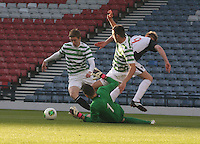 Blair Henderson surrounded by (left to right) Stuart Findlay, Leonardo Fasan and Eoghan O'Connell in the Dunfermline Athletic v Celtic Scottish Football Association Youth Cup Final match played at Hampden Park, Glasgow on 1.5.13. .