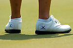 CHON BURI, THAILAND - FEBRUARY 20:  In Kyung Kim's shoes personalised with the South Korea national colors pictured during day four of the LPGA Thailand at Siam Country Club on February 20, 2011 in Chon Buri, Thailand. Photo by Victor Fraile / The Power of Sport Images
