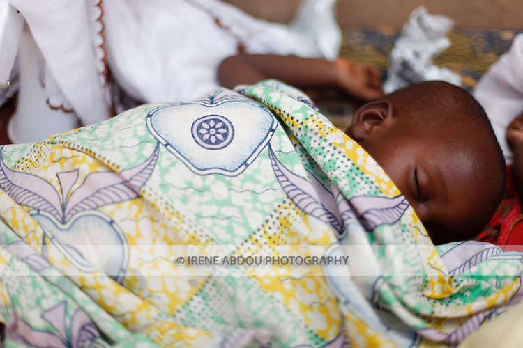 A Fulani child sleeps on a mat in Burkina Faso's capital city of Ouagadougou.