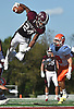 Trevor Yeboah-Kodie #24 of Garden City leaps into the air to clear a Carey defender and get to within inches of the goal line during a Nassau County Conference II varsity football game at Garden City High School on Saturday, Sept. 29, 2018. Garden City won by a score of 38-14.