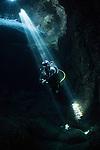 Diver exploring Blue Cave, Vis, Croatia