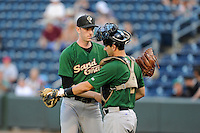 Pitcher Jimmy Duff (25) of the Savannah Sand Gnats embraces catcher Tyler Moore (2) after getting a save in a game against the Greenville Drive on Sunday, July 5, 2015, at Fluor Field at the West End in Greenville, South Carolina. Savannah won, 8-6. (Tom Priddy/Four Seam Images)