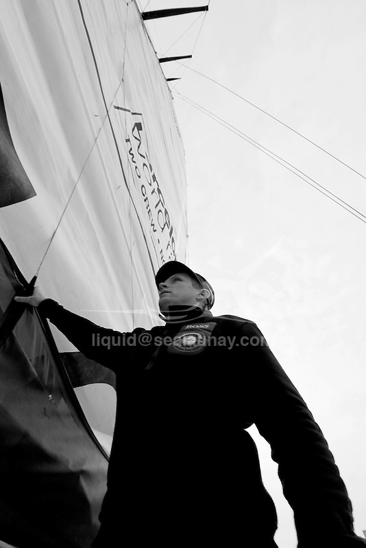 Preparation two days before the start of the Barcelona World Race, Barcelona, Spain..Alex Thomson and Andy Meiklejohn crew on the IMOCA 60 Hugo Boss design by Juan kouyoumdjian  preparing for the Barcelona World Race..The Barcelona World Race is the first only double-handed (two-crew) regatta around the world. This is a non-stop regatta with some outside assistance permitted, although subject to rules and  penalties.
