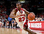 MADISON, WI - NOVEMBER 8: Guard Kammron Taylor #23 of the Wisconsin Badgers drives to the hoop against the Carroll College Pioneers at the Kohl Center on November 8, 2006 in Madison, Wisconsin. The Badgers beat the Pioneers 81-61. (Photo by David Stluka)