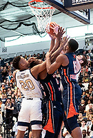 WASHINGTON, DC - NOVEMBER 16: Ace Stallings #20 and Jamison Battle #10 of George Washington clash with Lagio Grantsaan #15 of Morgan State under the basket during a game between Morgan State University and George Washington University at The Smith Center on November 16, 2019 in Washington, DC.
