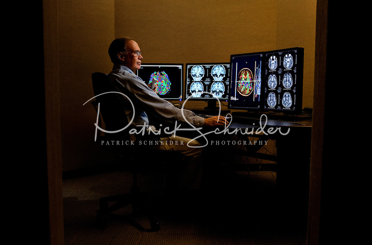 Photography in the Central Radiology Reading area at Carolinas Medical Center.  Looking at scan of the brain.