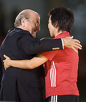 FIFA president Sepp Blatter embraces retired Chinese player SUn Wen during the opening ceremonies for the FIFA Women's World Cup China 2007 at Hongkou Stadium in Shanghai, China on September 10, 2007.