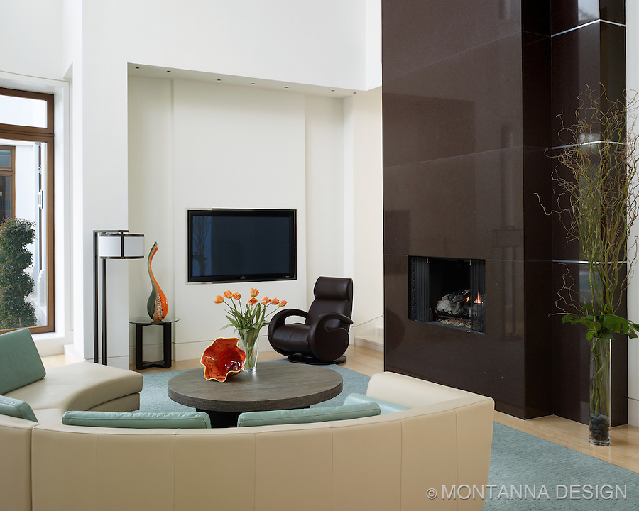 Clean warm family room showcases art glass