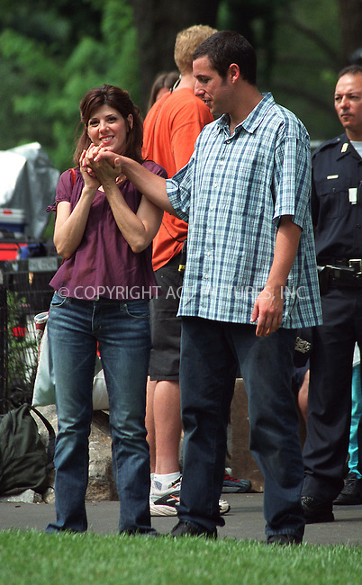 """Marisa Tomei and Adam Sandler on the set of """"Anger Management"""" in Central Park, New York, July 1, 2002. Please byline: Alecsey Boldeskul/NY Photo Press.   ..*PAY-PER-USE*      ....NY Photo Press:  ..phone (646) 267-6913;   ..e-mail: info@nyphotopress.com"""