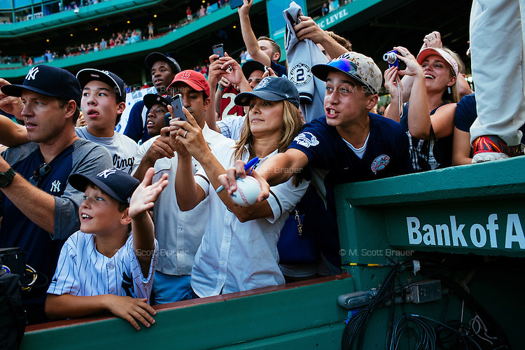 BOSTON, MASS. - SEPT. 28, 2014: Fans try to get Derek Jeter's attention after the New York Yankees and Boston Red Sox played at Fenway Park. The game is last game of Derek Jeter's career. M. Scott Brauer for The New York Times
