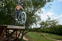 NWA Democrat-Gazette/BEN GOFF • @NWABENGOFF<br /> Tylar (CQ) Furr of Fayetteville rides on Friday Aug. 14, 2015 at the Slaughter Pen freeride park in Bentonville.