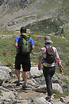 Couple hiking in the Indian Peaks Wilderness Area, west of Boulder, Colorado.
