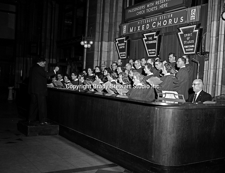 Pittsburgh PA:  During the holidays, the Pennsylvania Railroad's Mixed Chorus performed after work - 1955