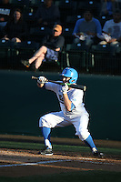 Brett Stephens (9) of the UCLA Bruins bunts during a game against the North Carolina Tar Heels at Jackie Robinson Stadium on February 20, 2016 in Los Angeles, California. UCLA defeated North Carolina, 6-5. (Larry Goren/Four Seam Images)