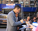 General Hospital's executive producer Frank Valentini signs for fans after taping Katie Couric's Talk Show on April 2, 2013 in New York City, New York. Fans came to the show and were outside the studio to greet the actors as they left. (Photo by Sue Coflin/Max Photos)