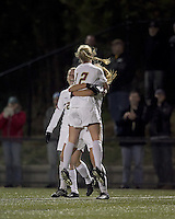"Boston College midfielder Julia Bouchelle (12) celebrates her goal with teammates. Boston College defeated West Virginia, 4-0, in NCAA tournament ""Sweet 16"" match at Newton Soccer Field, Newton, MA."