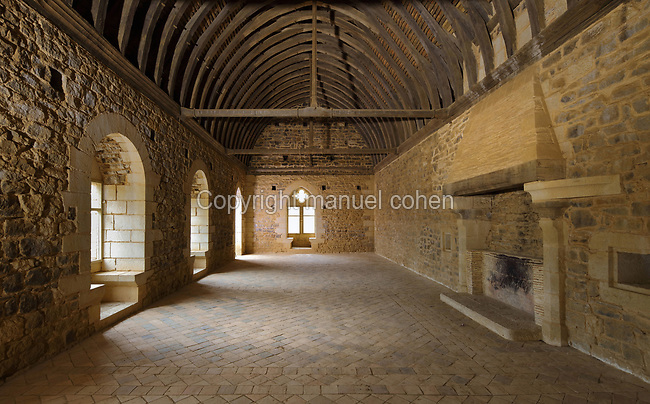 Great Hall or Grande Salle of the North Range or Logis Seigneurial, completed in 2010, with windows and barrel vaulted ceiling, at the Chateau de Guedelon, a castle built since 1997 using only medieval materials and processes, photographed in 2017, in Treigny, Yonne, Burgundy, France. The Guedelon project was begun in 1997 by Michel Guyot, owner of the nearby Chateau de Saint-Fargeau, with architect Jacques Moulin. It is an educational and scientific project with the aim of understanding medieval building techniques and the chateau should be completed in the 2020s. Picture by Manuel Cohen